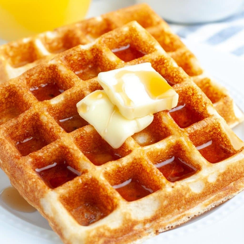 Two square waffles on a plate.