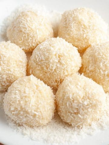 Plate of dessert balls with coconut.