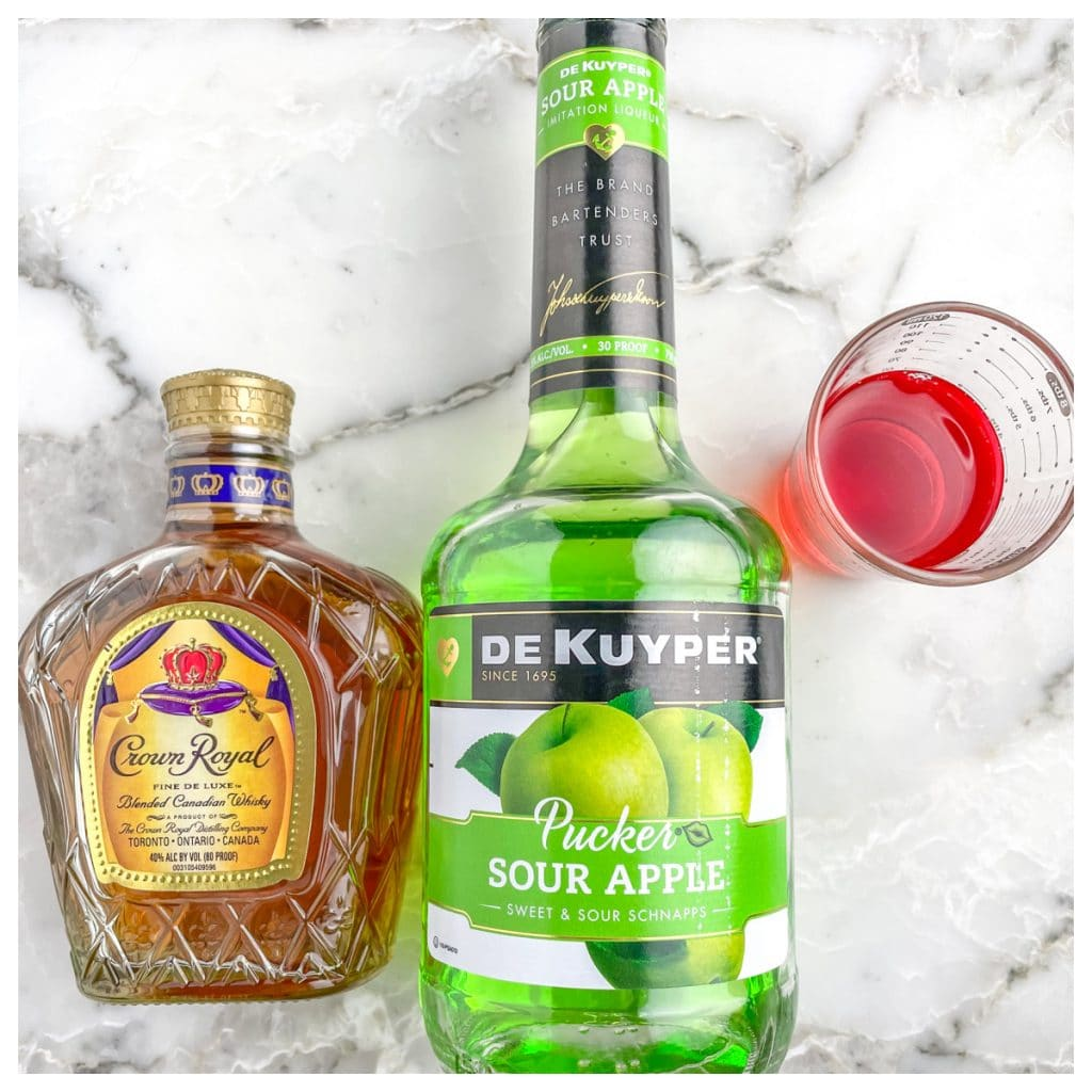 Bottle of Crown Royal, apple schnapps, and cranberry juice.